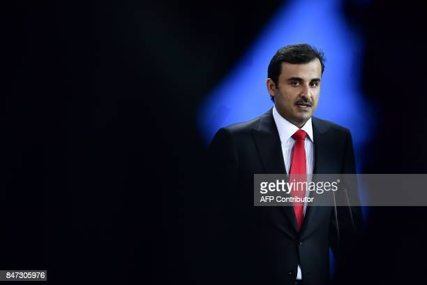 Qatar's Emir Sheik Tamim bin Hamad alThani addresses a joint press conference with the German Chancellor after talks at the Chancellery in Berlin on...