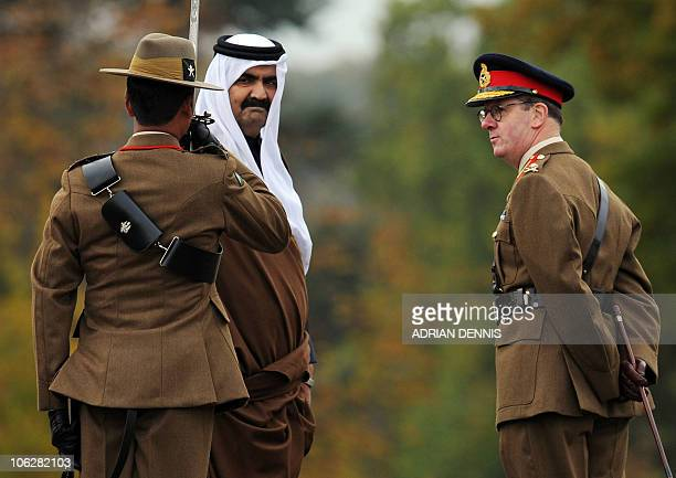 Qatar's Emir Sheikh Hamad bin Khalifa alThani walks past a Gurkha officer as he is escorted by Commandant General Marriot upon his arrival at The...