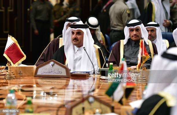 Qatar's Emir Sheikh Tamim bin Hamad AlThani and Foreign Minister Mohammed bin Abdulrahman alThani attend the Gulf Cooperation Council summit at Bayan...