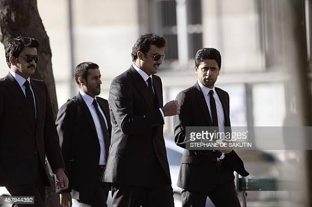 Qatar's Emir Sheikh Tamim bin Hamad alThani and his brother Qatar's Shiekh Joaan bin Hamad bin Khalifa alThani and Paris SaintGermain's Qatari...