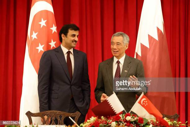 Qatar's Emir Sheikh Tamim bin Hamad alThani and Singapore Prime Minister Lee Hsien Loong attends the signing of Memorandum of Understanding at the...