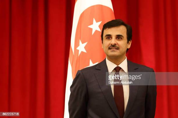 Qatar's Emir Sheikh Tamim bin Hamad alThani arrives at the signing of Memorandum of Understanding between Qatar and Singapore at the Istana on...