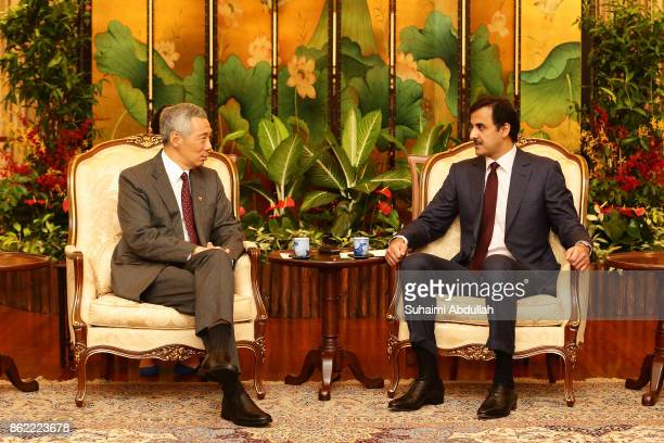 Qatar's Emir Sheikh Tamim bin Hamad alThani meets with Singapore Prime Minister Lee Hsien Loong at the Istana on October 17 2017 in Singapore It is...