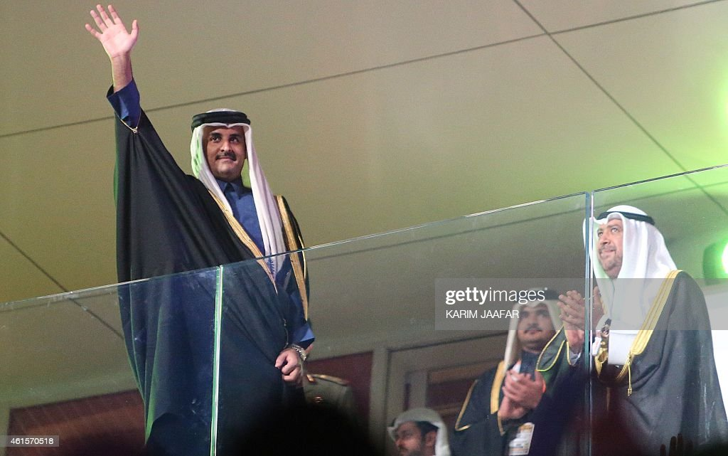 Qatar's Emir Sheikh Tamim bin Hamad Al-Thani waves during the 24th Men's Handball World Championships opening ceremony at the Lusail Multipurpose Hall in Doha on January 15, 2015.
