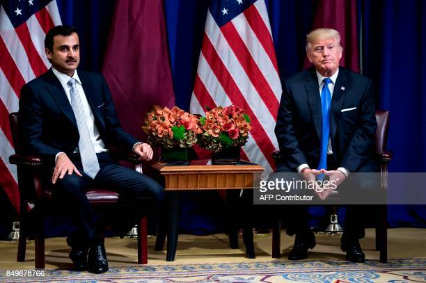 Qatar's Emir Tamim bin Hamad alThani and US President Donald Trump wait for a meeting at the Palace Hotel on September 19 2017 in New York City on...