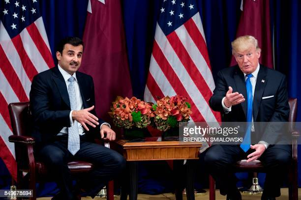 Qatar's Emir Tamim bin Hamad alThani and US President Donald Trump make comments for the press before a meeting at the Palace Hotel on September 19...