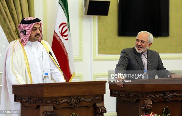 Qatar's Foreign Minister Khalid alAttiyah holds a joint press conference with his Iranian counterpart Mohammad Javad Zarif on February 26 2014 in...