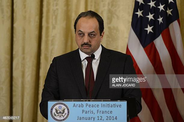 Qatar's Foreign Minister Khalid alAttiyah listens to US Secretary of State John Kerry during a joint press conference at the US Ambassador's...