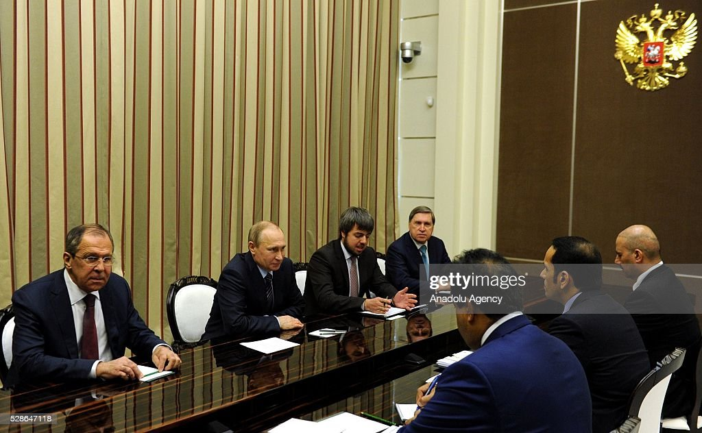 Qatar's Foreign Minister Sheikh Mohammed bin Abdulrahman bin Jassim Al Thani (2nd R), Russian President Vladimir Putin (2nd L) and Russia's Foreign Minister Sergei Lavrov (L) are seen during a meeting in Sochi, Russia on May 6, 2016.