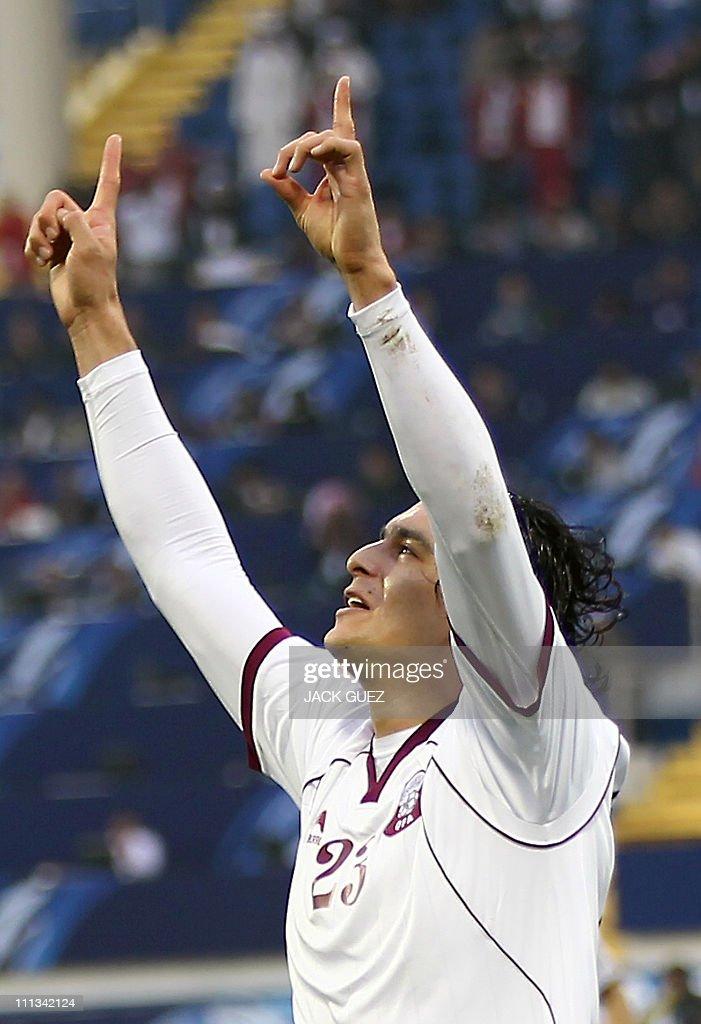 Qatar's forward Sebastian Soria celebrates after he scores his team's first goal against Japan during their 2011 Asian Cup quarterfinal football...
