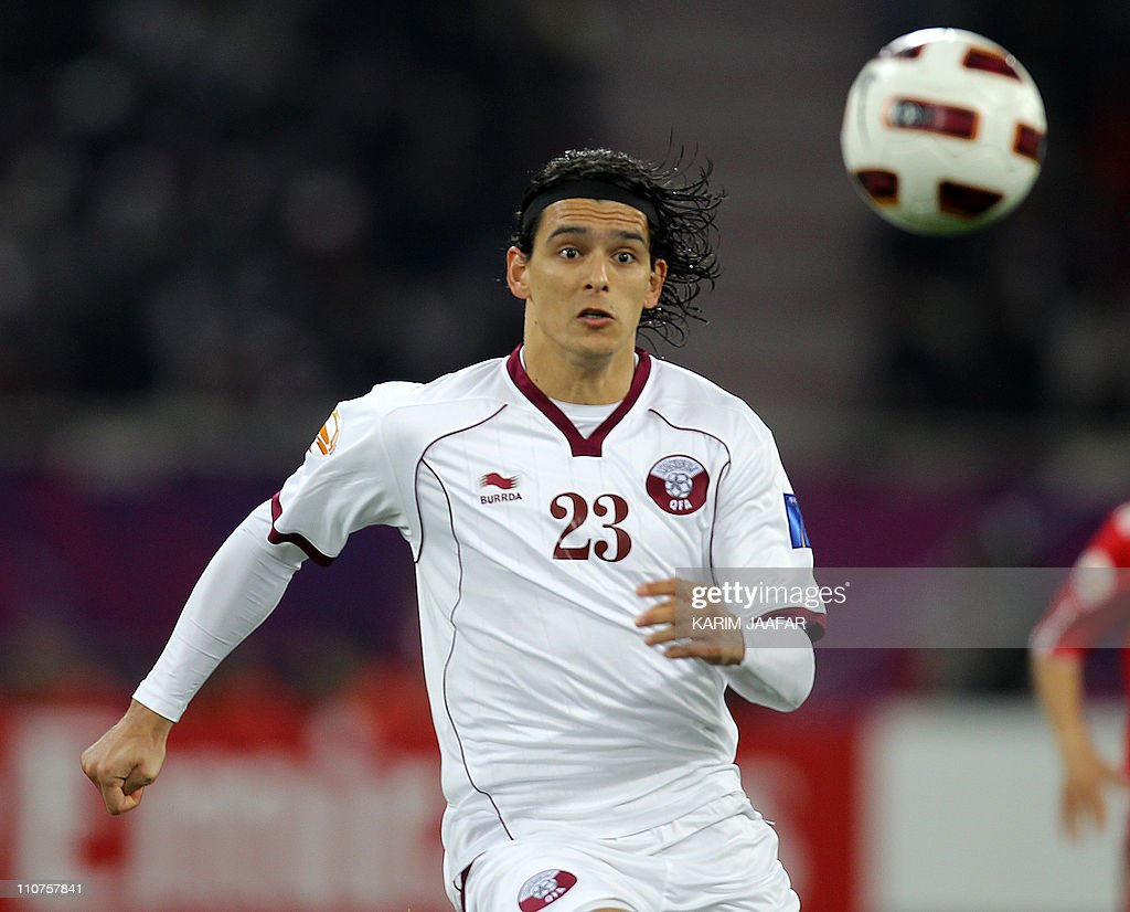 Qatar's forward Sebastian Soria controls the ball during the 2011 Asian Cup group A football match between China and Qatar at Khalifa Stadium in the...