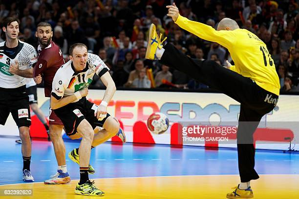 Qatar's goalkeeper Danijel Saric deflects a shot from Germany's right back Holger Glandorf during the 25th IHF Men's World Championship 2017 eighth...