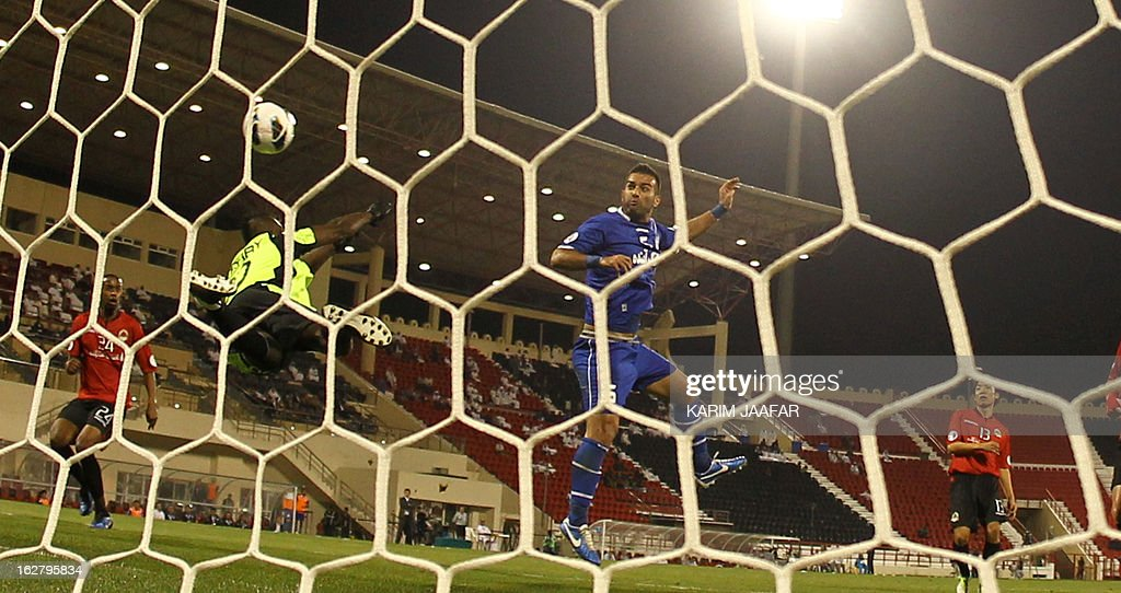 Qatar's goalkeeper Oumar Barry jumps to stop a shoot during the AFC Champions League football match Iran's Esteghlal versus Qatar's al-Rayyan clubs in the Qatari capital Doha on February 27, 2013. AFP PHOTO / AL-WATAN DOHA / KARIM JAAFAR == QATAR OUT ==