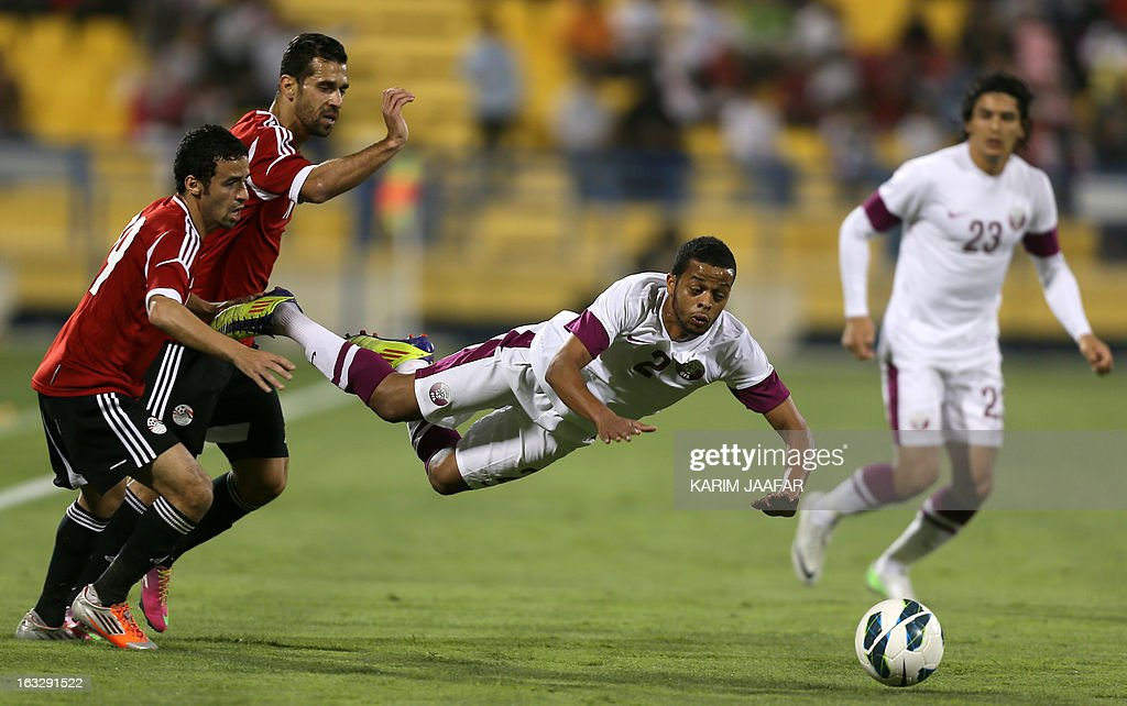 Qatar's Hamed Ismail (C) vies with Egypt's players Ahmed Shedid Qinawi (L) and Abdullah El-Said (2ndL) during the friendly football match Qatar versus Egypt in the Qatari capital Doha on March 7, 2013. The match comes in the frame of the both national teams preparation for Asian and African qualification rounds for FIFA 2014 World Cup Finals in Brazil.