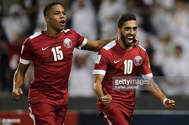 Qatar's Hasan alHaydos celebrates after scoring a penalty during the 2018 World Cup qualifying football match between Qatar and Syria at the Jassim...