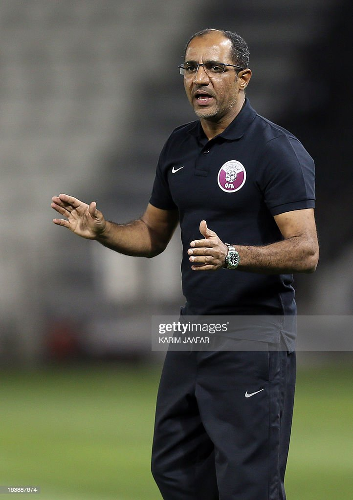 Qatar's head coach Fahad Thani gestures to his players during their friendly football match against Thailand in the Qatari capital Doha on March 17, 2013.