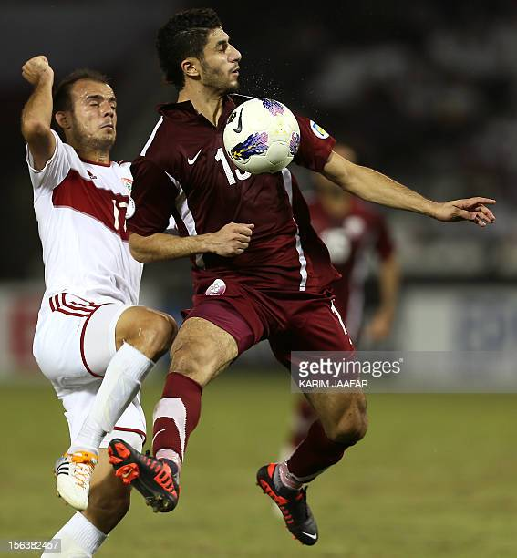 Qatar's Ibrahim Majed challenges Lebanon's Mahmud alAli during their 2014 World Cup Asian zone group A qualifying football match in Doha on November...