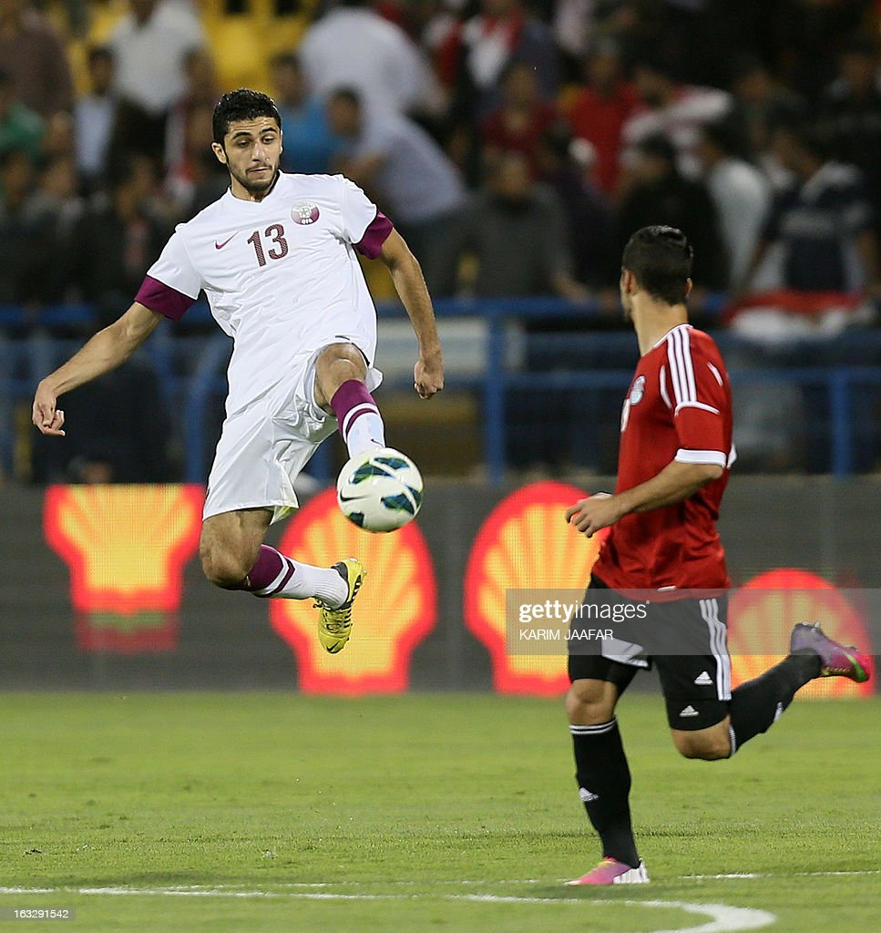 Qatar's Ibrahim Majed (L) controls the ball in front of Egypt's Abdullah El-Said during the friendly football match Qatar versus Egypt in the Qatari capital Doha on March 7, 2013. The match comes in the frame of the both national teams preparation for Asian and African qualification rounds for FIFA 2014 World Cup Finals in Brazil.