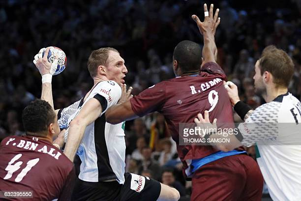Qatar's left back Rafael Capote defends against Germany's right back Holger Glandorf during the 25th IHF Men's World Championship 2017 eighth final...