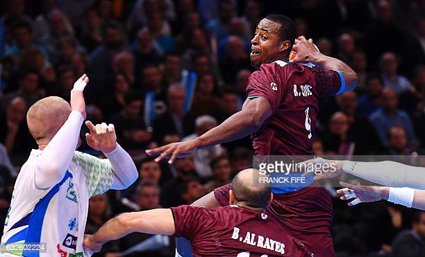 TOPSHOT Qatar's left back Rafael Capote jumps to shoot on goal over Slovenia's pivot Matej Gaber during the 25th IHF Men's World Championship 2017...