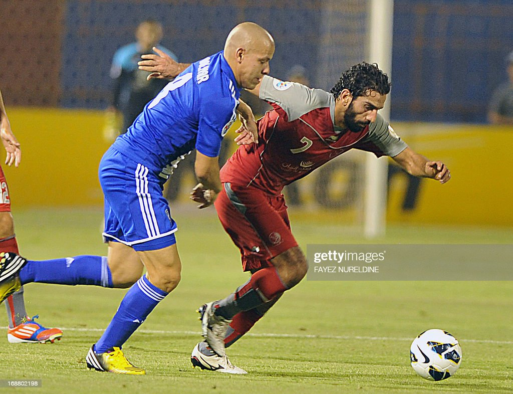 Qatar's Lekhwiya Adel Lamy (R) fights for the ball with Saudi's Al Hilal player Gustavo Bolivar during their AFC Champions League football match on May 15, 2013 at the Prince Faisal bin Fahad stadium in Riyadh.
