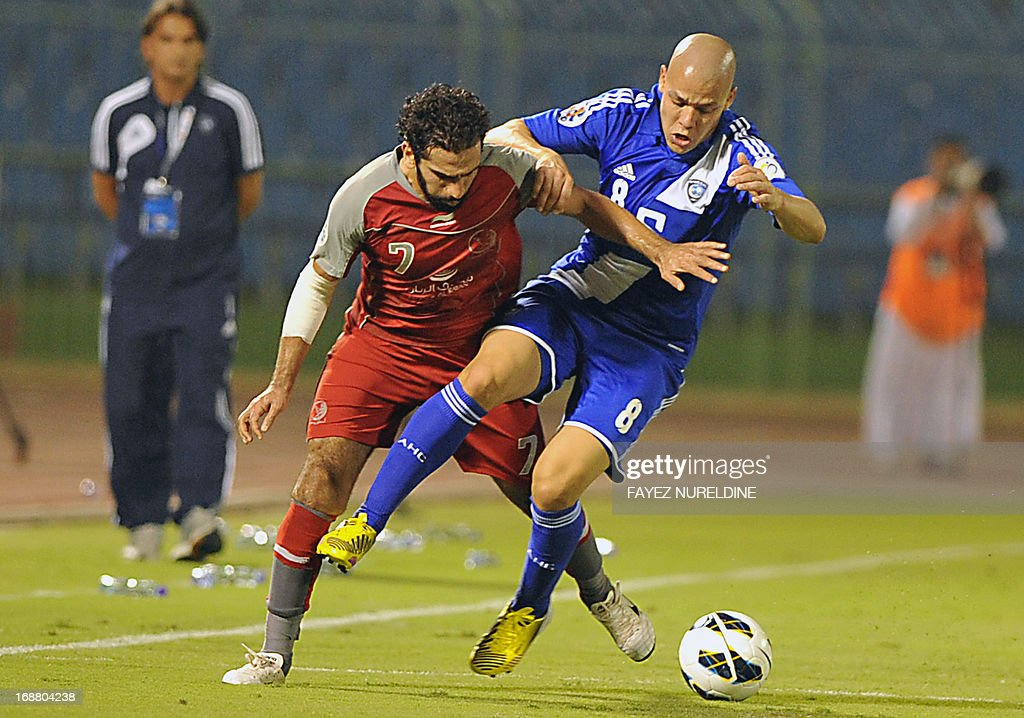 Qatar's Lekhwiya Adel Lamy (L) fights for the ball with Saudi's Al Hilal player Gustavo Bolivar during their AFC Champions League football match on May 15, 2013 at the Prince Faisal bin Fahad stadium in Riyadh.