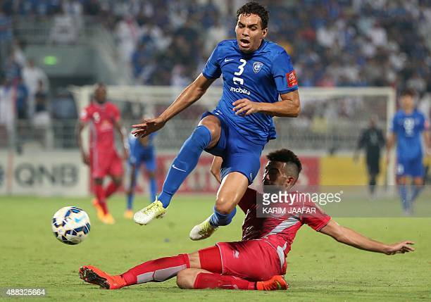 Qatar's Lekhwiya defender Ahmed Yasser vies for the ball with Saudi Arabia's alHilal midfielder Carlos Eduardo during their AFC Championship league...