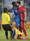 Qatar's Lekhwiya defender Chico Flores reacts against Saudi Arabia's alHilal midfielder Faisal Darwish during their AFC Championship league...