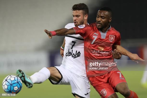 Qatar's Lekhwiya forward Ismail Mohamad and Iran's Persepolis FC midfielder Soroush Rafieitelgary vie for the ball during the AFC Champions League...