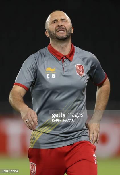 Qatar's Lekhwiya Head Coach Djamal Belamdi reacts after his team scored an own goal giving Persepolis FC a 10 lead during the AFC Champions League...