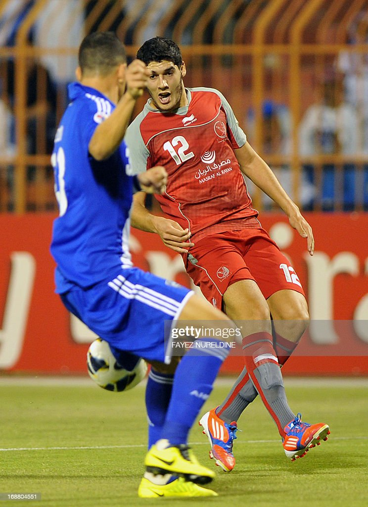 Qatar's Lekhwiya Karim Boudiaf (R) vies with Saudi's Al Hilal player Salem Aldawsari (L) during their AFC Champions League football match on May 15, 2013 at the Prince Faisal bin Fahad stadium in Riyadh.