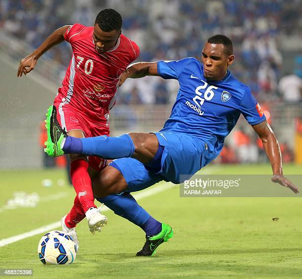 Qatar's Lekhwiya midfielder Ismail Mohammed vies for the ball with Saudi Arabia's alHilal defender Digao during their AFC Championship league...