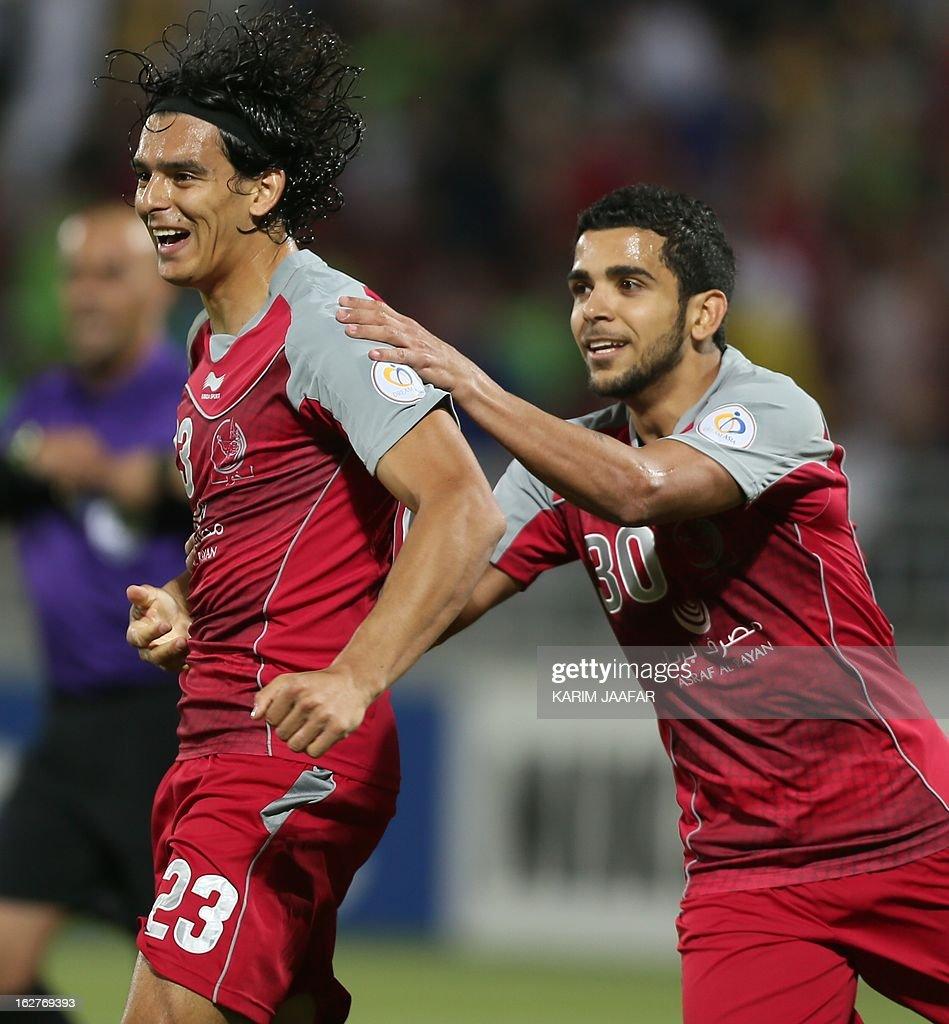 Qatar's Lekhwiya player Sebastian Soria celebrates after scoring a first goal against UAE's AlShabab club during their AFC Champions League football...