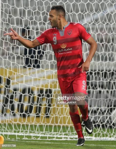 Qatar's Lekhwiya player Youssef ElArabi celebrates after scoring during the Asian Champions League football match between Qatar's Lekhwiya SC and...
