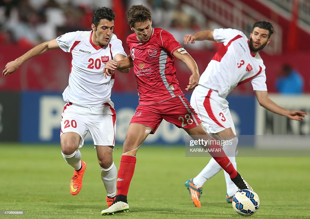 Qatar's Lekhwiya player <a gi-track='captionPersonalityLinkClicked' href=/galleries/search?phrase=Youssef+Msakni&family=editorial&specificpeople=5672735 ng-click='$event.stopPropagation()'>Youssef Msakni</a> (C) fights for the ball with Alireza Nourmohammadi (L) and Mohammad Khanzadeh (R) of Iran's Persepolis during their AFC Champions League football match at the Abdullah Bin Khalifa Stadium in Doha, on April 22, 2015. Lekhwiya won the match 3-0.