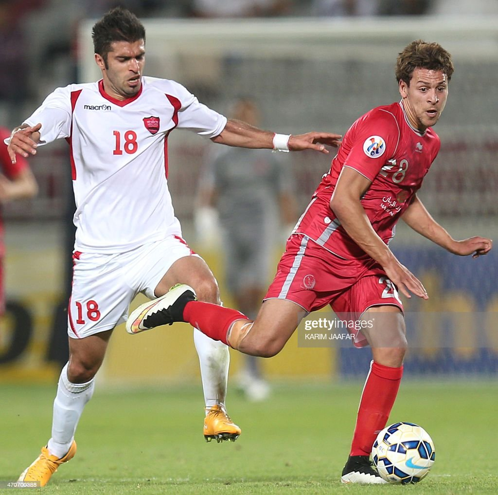 Qatar's Lekhwiya player <a gi-track='captionPersonalityLinkClicked' href=/galleries/search?phrase=Youssef+Msakni&family=editorial&specificpeople=5672735 ng-click='$event.stopPropagation()'>Youssef Msakni</a> (R) fights for the ball with Mehrdad Kafshagri (L) of Iran's Persepolis during their AFC Champions League football match at the Abdullah Bin Khalifa Stadium in Doha on April 22, 2015.