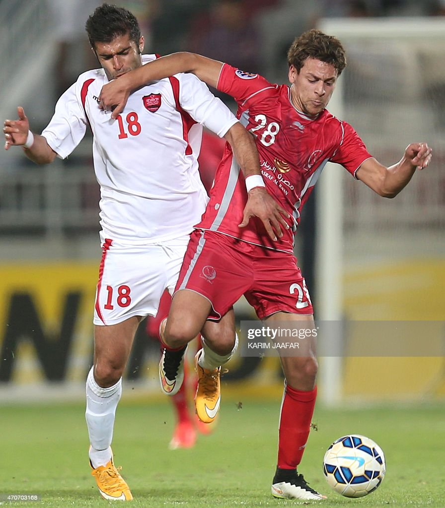 Qatar's Lekhwiya player <a gi-track='captionPersonalityLinkClicked' href=/galleries/search?phrase=Youssef+Msakni&family=editorial&specificpeople=5672735 ng-click='$event.stopPropagation()'>Youssef Msakni</a> (R) fights for the ball with Mehrdad Kafshagri (L) of Iran's Persepolis during their AFC Champions League football match at the Abdullah Bin Khalifa Stadium in Doha, on April 22, 2015.