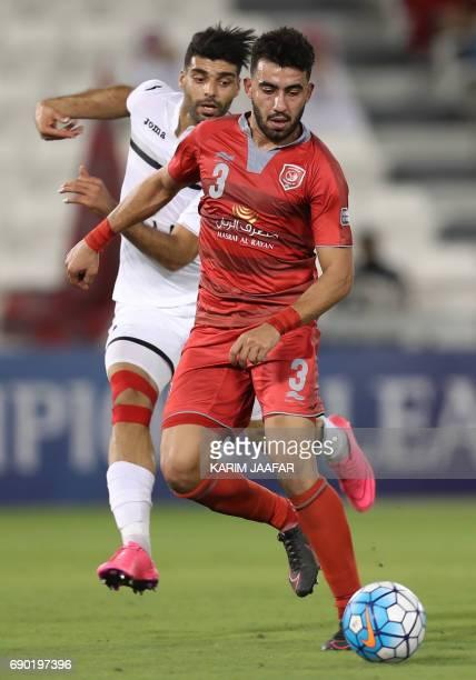 Qatar's Lekhwiya SC defender Ahmed Yasser Andelrahman dribbles the ball as Iran's Persepolis FC forward Mehdi Taremi defends during the AFC Champions...