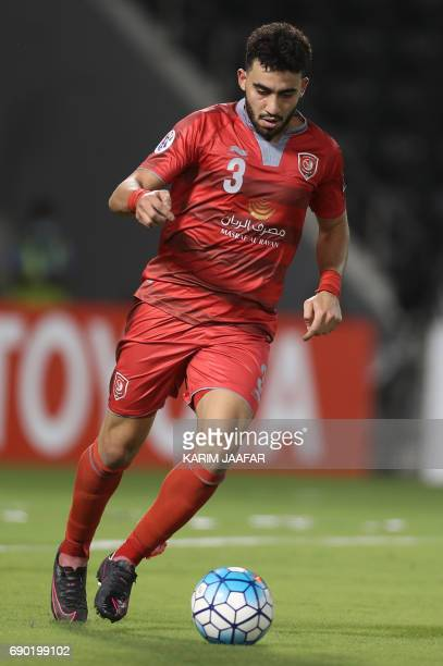 Qatar's Lekhwiya SC defender Ahmed Yasser Andelrahman dribbles the ball during the AFC Champions League football match between Qatar's Lekhwiya club...