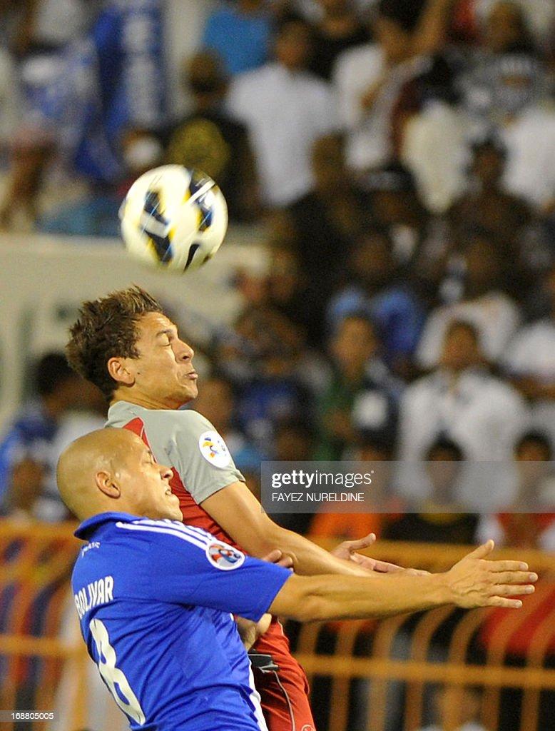 Qatar's Lekhwiya Youssef Msakni (R) fights for the ball with Saudi's Al Hilal player Gustavo Bolivar during their AFC Champions League football match on May 15, 2013 at the Prince Faisal bin Fahad stadium in Riyadh.