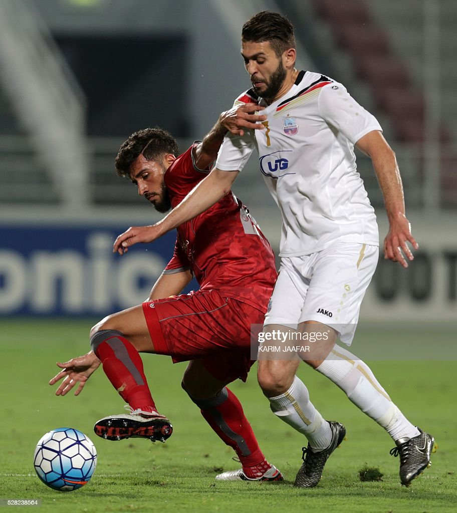 Qatar's Lekhwiya's Khaled Radwan (L) fights for the ball against Uzbekistan's Bunyodkor's Chaker Zouaghi during their Asian Champions League football match at Abdullah bin Khalifa Stadium in Doha on May 4, 2016. / AFP / KARIM