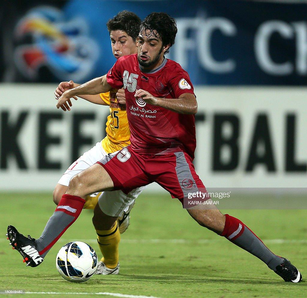 Qatar's Lekhwiya's Sebastian Soria vies for the ball against China's Guangzhou Evergrande Dario Leonardo Conca during their AFC Championship league...