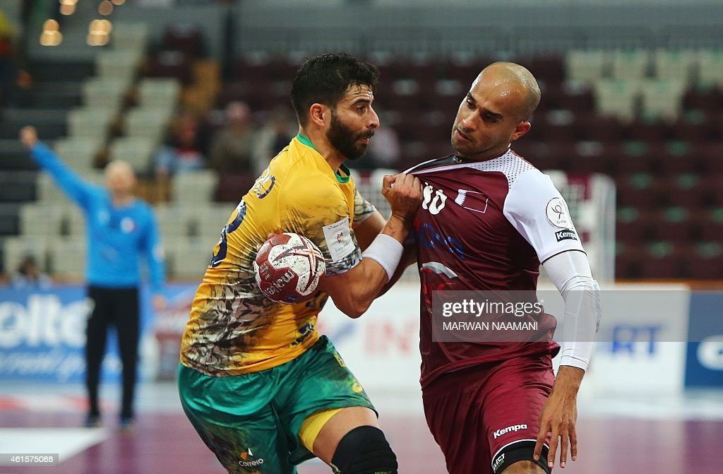 Qatar's Mahmoud Hassab Alla (R) tries to get past Brazil's <a gi-track='captionPersonalityLinkClicked' href=/galleries/search?phrase=Felipe+Ribeiro&family=editorial&specificpeople=4113764 ng-click='$event.stopPropagation()'>Felipe Ribeiro</a> during the 24th Men's Handball World Championships preliminary round Group A match Qatar vs Brazil at the Lusail Multipurpose Hall in Doha on January 15, 2015.