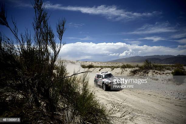 Qatar's Mini driver Nasser AlAttiyah of Qatar and codriver Lucas Cruz compete during the Stage 5 of the Dakar 2014 between Chilecito and Tucuman...