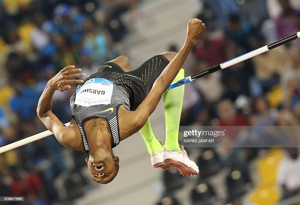 Qatar's Mutaz Essa Barshim competes in the High Jump final event at the Diamond League athletics meeting at the Suhaim bin Hamad Stadium in Doha on May 6, 2016. / AFP / KARIM