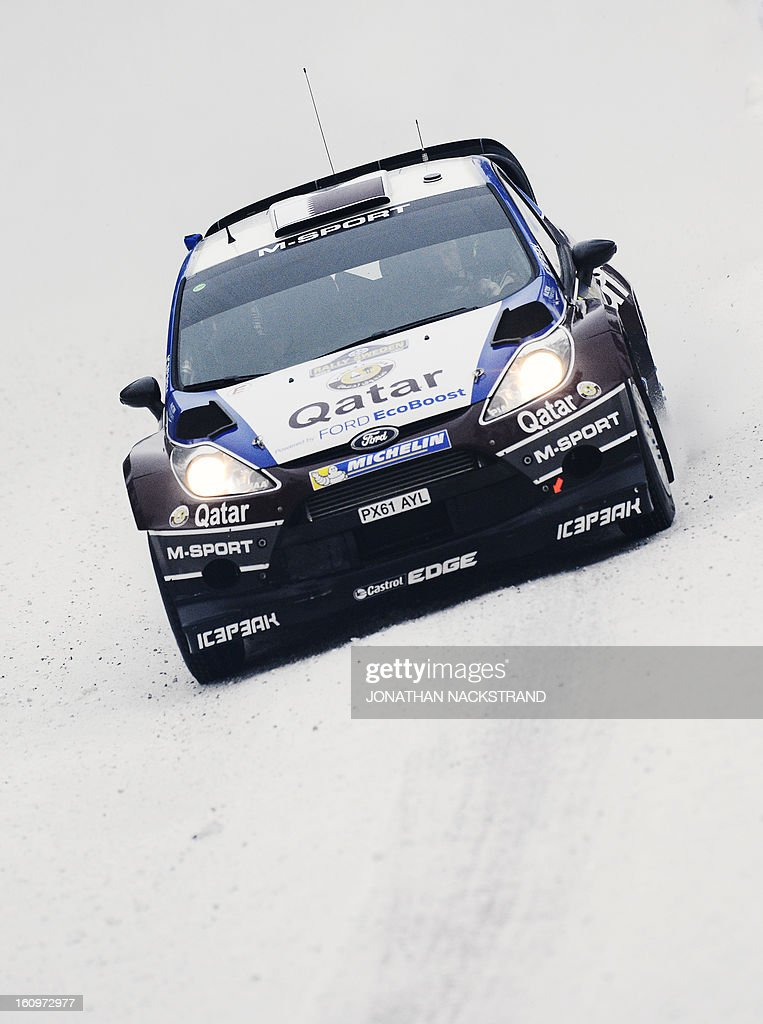 Qatar's Nasser Al-Attiya and his co-driver Italy's Giovanni Bernacchini steer their Ford Fiesta RS WRC during Vargasen stage, the 7th of Rally Sweden, second round of the FIA World Rally Championship on February 8, 2013 near Hagfors, north of Karlstad, Sweden.