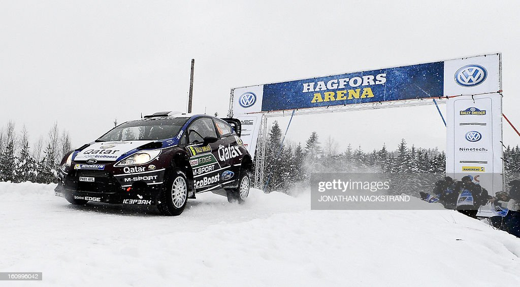 Qatar's Nasser Al-Attiya and his co-driver Italy's Giovanni Bernacchini steer their Ford Fiesta RS WRC during the 3rd stage of the Sweden Rally, during the second round of the FIA World Rally Championship on February 8, 2013 in Hagfors, Sweden.