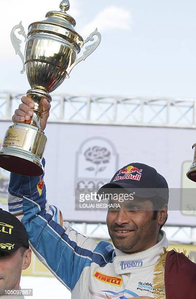 Qatar's Nasser alAttiyah celebrate his win in the 10th Syrian International Rally round six of the FIA Middle East Rally Championship in Sednaya some...