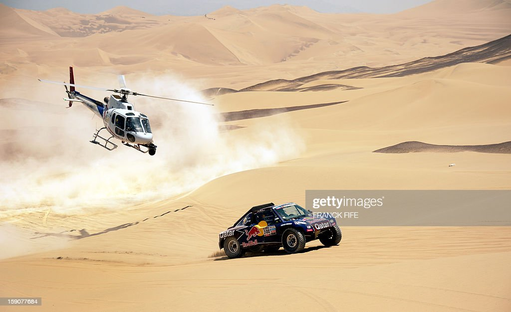 Qatar's Nasser Al-Attiyah competes during Stage 3 of the Dakar Rally 2013 between Pisco and Nazca, Peru, on January 7, 2013. The rally will take place in Peru, Argentina and Chile from January 5-20.