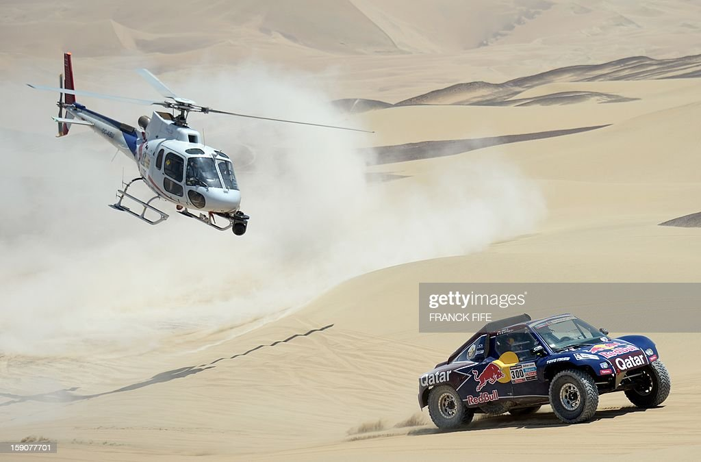 Qatar's Nasser Al-Attiyah competes during Stage 3 of the Dakar Rally 2013 between Pisco and Nazca, Peru, on January 7, 2013. The rally will take place in Peru, Argentina and Chile from January 5-20. AFP PHOTO / FRANCK FIFE